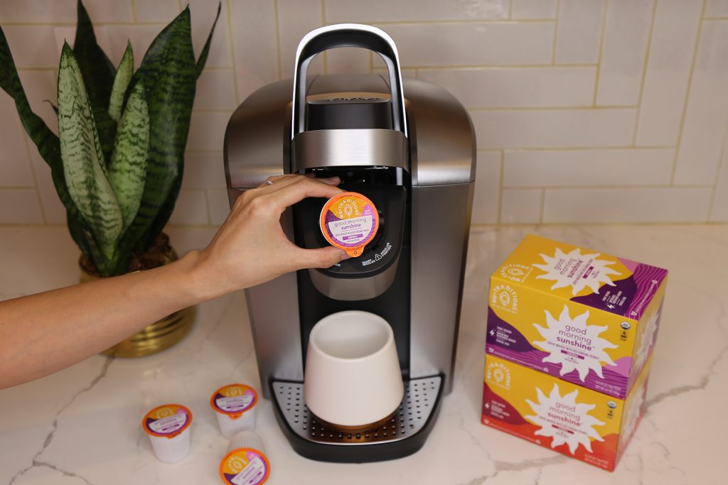 brewing a cup of NuTraditions Good Morning Sunshine adaptogen coffee in a Keurig machine