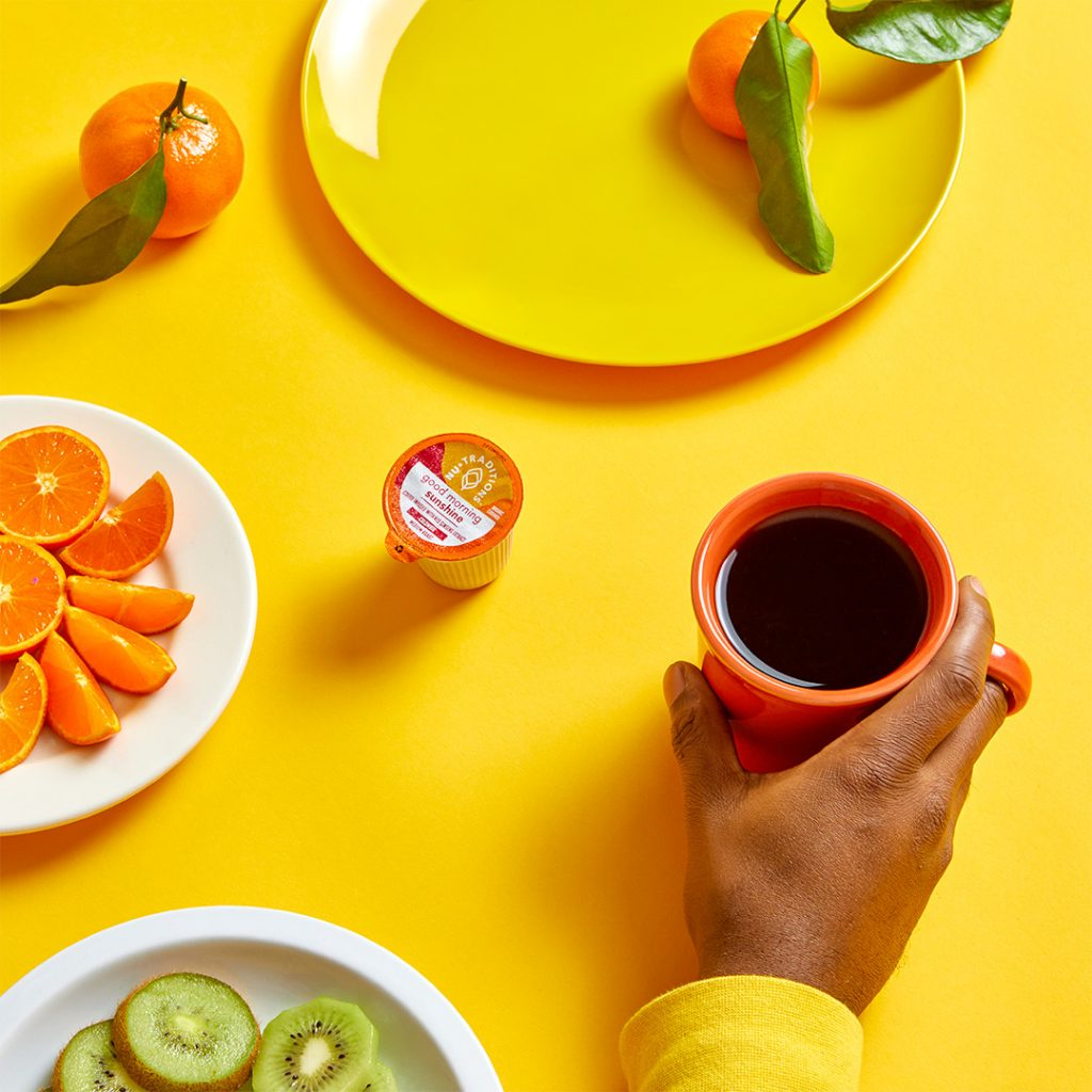 NuTraditions Good Morning Sunshine coffee staged with fruit