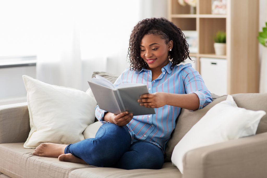a woman reading on a couch