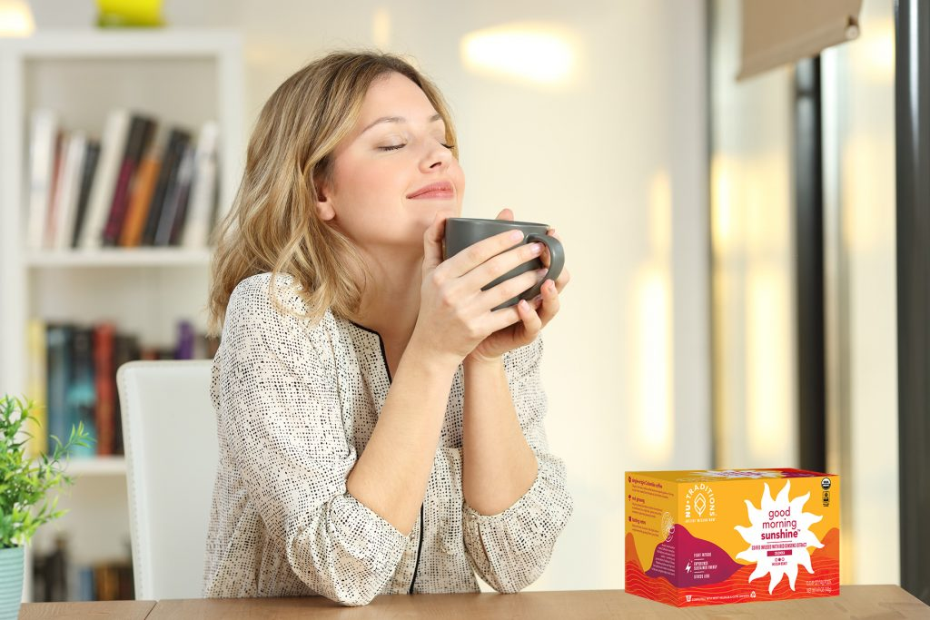 a person drinking Good Morning Sunshine adaptogen coffee and feeling energized