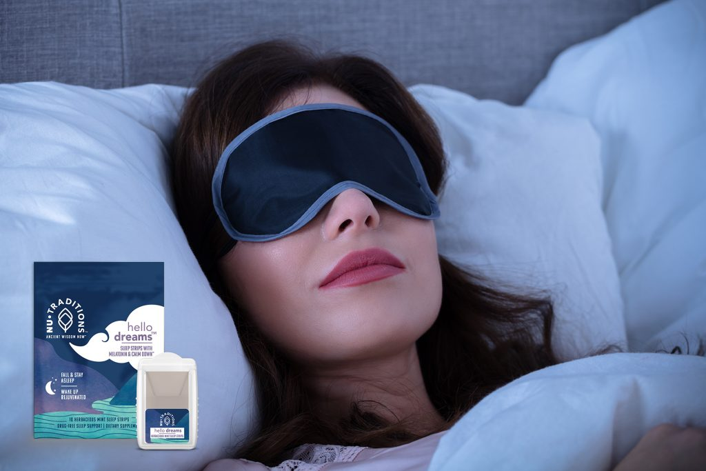 person sleeping with an eye mask on