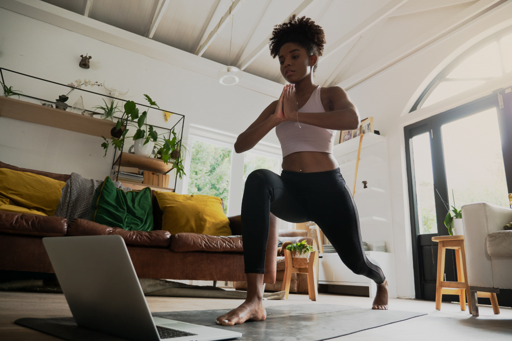 Woman doing yoga during her healthy morning routine