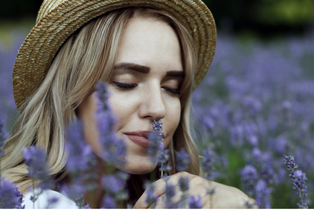 woman sniffing lavender flowers